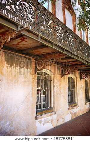 Savannah, GA, USA - 09/08/2016:Ornate ironwork on a balcony of a home on Bull Street in downtown Savannah GA