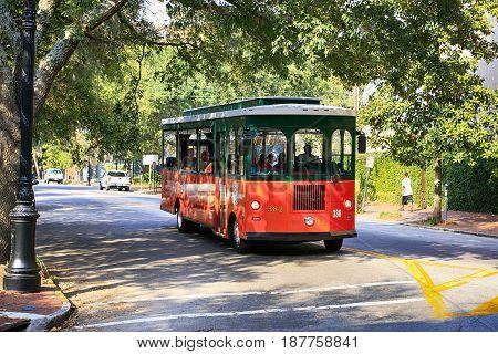 Savannah, GA, USA - 09/08/2016:Orange and Green bus tour vehicle in Savannah GA
