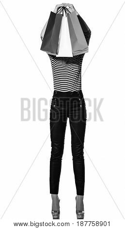 Young Fashion-monger Holding Shopping Bags On White
