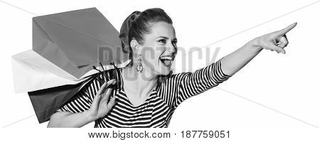 Stylish Woman With Shopping Bags On White Pointing At Something