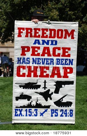 DENVER - AUGUST 26: A conservative demonstrator holds a sign promoting US military power during the Democratic National Convention on August 26, 2008 in Denver, Colorado.