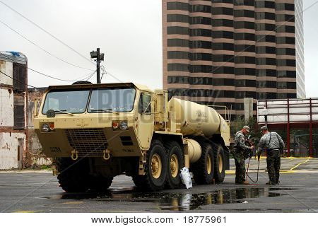 NEW ORLEANS - SEPT 1: National Guardsmen stand next to a fuel tanker after Hurricane Gustav passed the area on September 1, 2008 in downtown New Orleans.