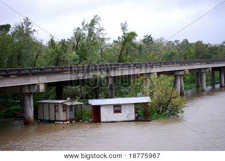 NEW ORLEANS - SEPT 1: Shacks stuck in vegetation float under a freeway during Hurricane Gustav on September 1, 2008 in New Orleans.