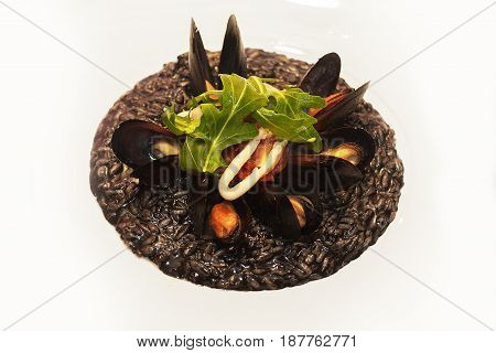 Fresh mussels at grill pan. Seafood barbecue outdoors. Picnic healthy food, mussels in shells. Plenty of mussel shells cooking at large metallic pan. Steamed and stewed mussels, mediterranean cuisine