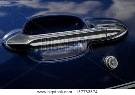 Close view of a classic car door handle