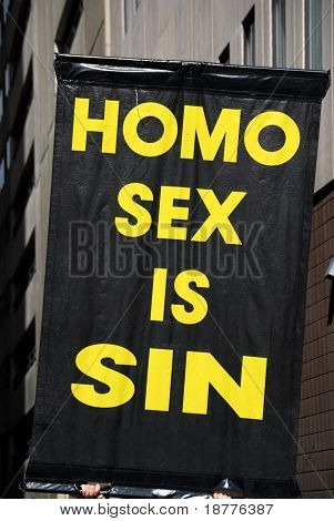 Poster claiming gay sex as sin, held up during a demonstration