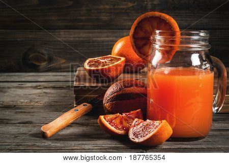 Refreshing Summer Drink. Juice From Red Sicilian Oranges. On A Rustic Wooden Table, With Whole And C