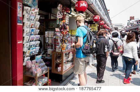 Tokyo Japan - May 1 2017:Tourist is checking out the goods in Sensoji Shopping street.