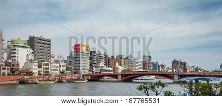 Tokyo Japan - May 4 2017: The red bridge across Sumida river to Asakusa Business area.