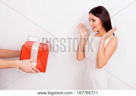 Oh Wow! Excited Young Cute Girl Receives A Present.  It Is Red With White Tape. Girl Is Dressed In W