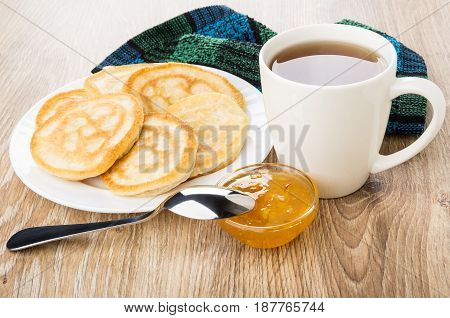 Pancakes In Plate, Orange Jam, Cup Of Tea And Spoon