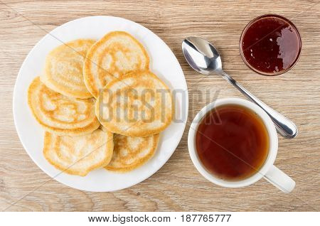 Pancakes In White Plate, Strawberry Jam, Cup Of Tea