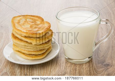 Stack Of Pancakes In Saucer And Transparent Cup With Milk