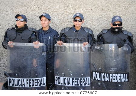 CIUDAD JUAREZ, MEXICO - FEB 27: Federal policemen waits for orders on February 27, 2009, in the violence-ridden border city of Ciudad Juarez, Mexico.