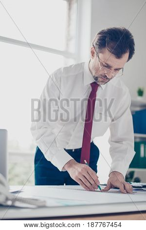 Businessman Is Drawing A Scheme Of New Ideas Foe Startups. He Is Standing By The Table, Wearing Shir
