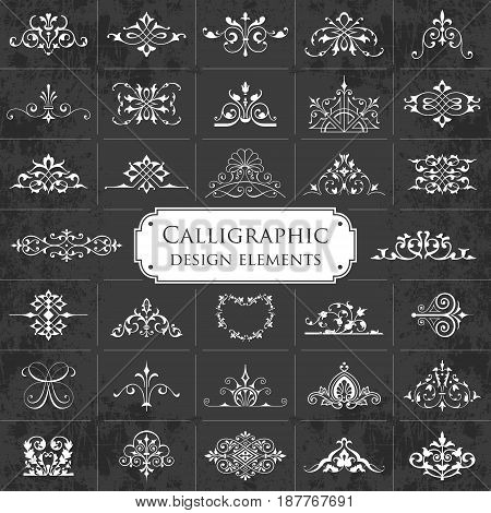 Large collection of ornate calligraphic design elements on a chalkboard background - vector set