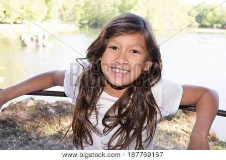 Young 10 Year Old Girl Near Lake Park
