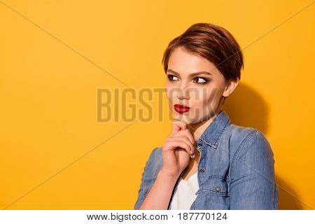 Close Up Portrait Of Minded Attractive Young Lady With Red Lipd Dressed In Jeans Shirt Thinking Abou