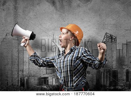 Engineer woman screaming in megaphone and sketches of construction project on wall