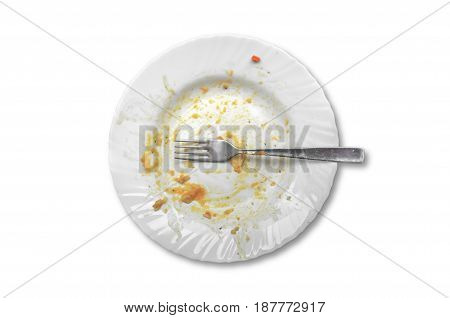 View from above on empty plate dirty after the meal is finished isolated on white