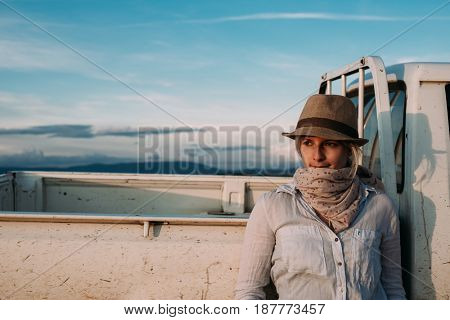 Traveler woman with pick up truck