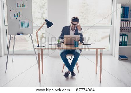 Full Size Of Young Pensive Businessman, Which Is Working On  Laptop At The Office. He Is Thinking Of
