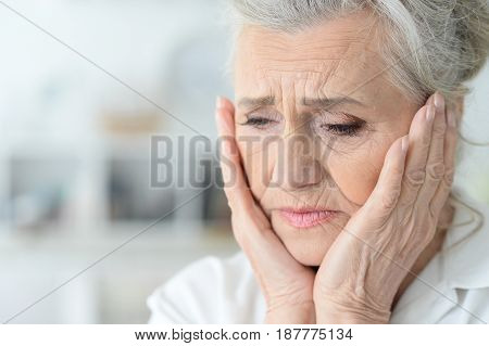 Portrait of a beautiful sad elderly woman