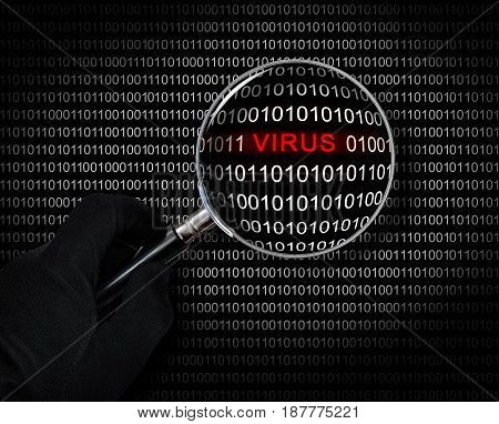 The concept of computer security. Hand with magnifying glass scans the binary code for viruses