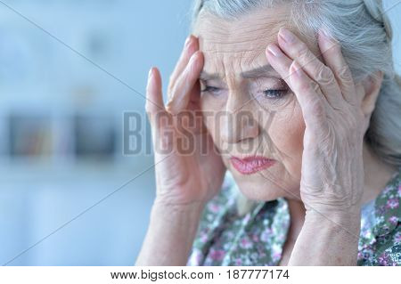 Portrait of a beautiful sad elderly woman close-up