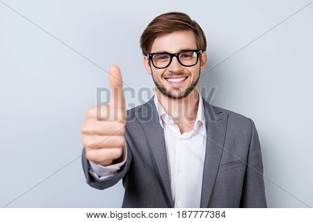 Successful Excited Bearded Young Guy In Glasses And Formal Wear Is Standing Isolated On A Pure Backg