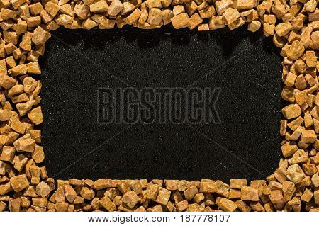 Frame With Natural Stone On A Black Background