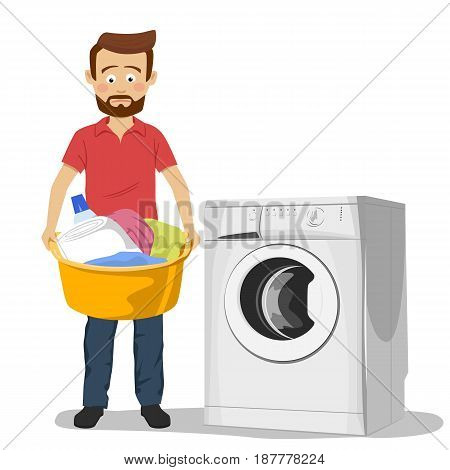 Unhappy young man standing next to washing machine with basin filled with dirty clothes over white background
