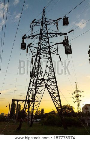 Power Line Against The Background Of Sunset. The Blue Sky. Sunset.
