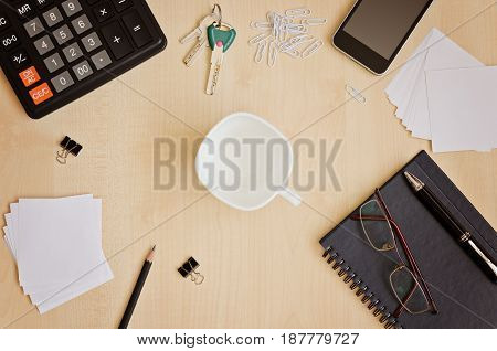 Top view office desk with notepads phone paper for notes calculator glasses and cup for coffee