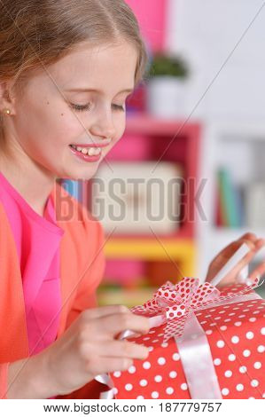 Portrait of a beautiful teen girl with a gift