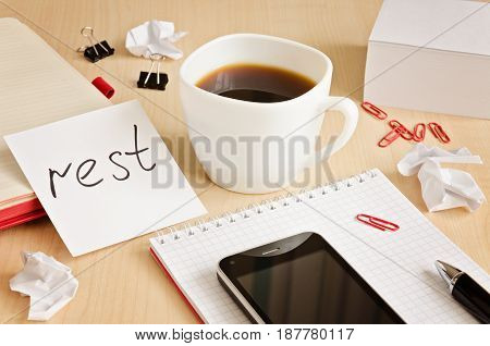 Office desk with notepads phone paper for notes and cup of coffee