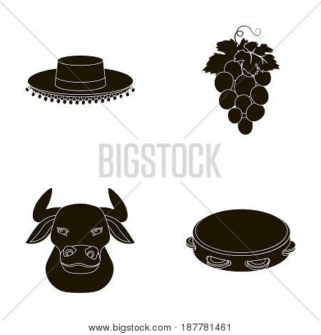 The hat of the todeador, the matador, a bunch of grapes with fists, a bull for the Spanish bullfight, a tambourine. Spain country set collection icons in black style vector symbol stock illustration .