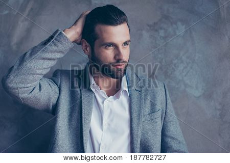Confident Pensive Handsome Brunette Bearded Young Man Is Looking Away Wearing Formal Wear, Fixing Hi