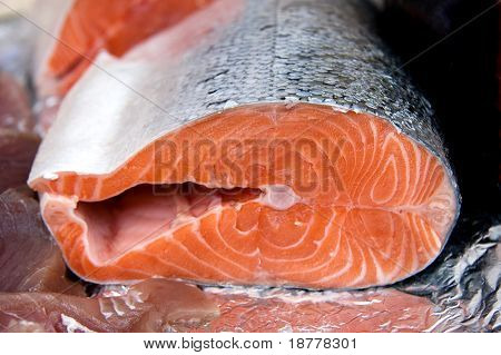 A cross section of a salmon for sale at a fish market