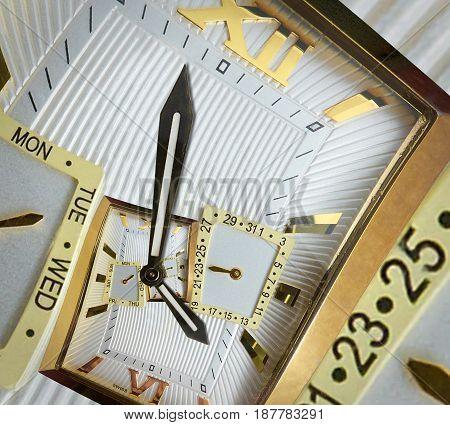 Modern classic golden watch clock abstract fractal spiral. Watch clock unusual abstract texture fractal pattern background. Incredible clock roman and arabic numerals clock hands. Watch spiral effect