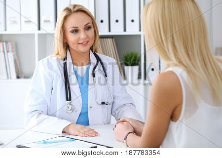 Doctor reassuring her female patient. Medicine, help and health care concept.
