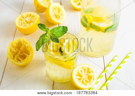Lemonade In Bottle And In Jar Decorated With Mint