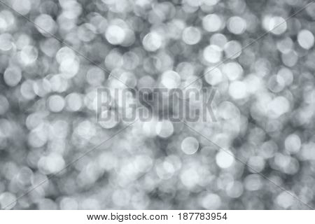 silver and white bokeh lights abstract background