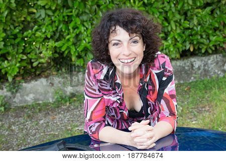 a laughs middle-aged woman with curly hair