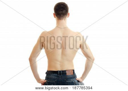 naked pumped up spin the younger guy who put hands on hips and turned his back to the camera isolated on white background