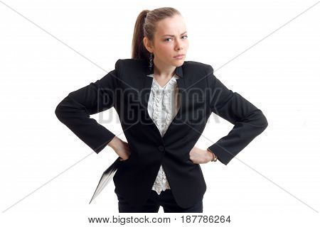 pretty disgruntled business blonde put hands on hips and looks into a camera isolated on white background