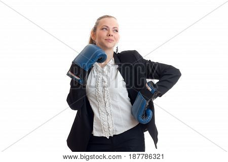 beautiful young girl in white shirt jacket and boxing gloves and lifted her head proudly looks afar is isolated on white background