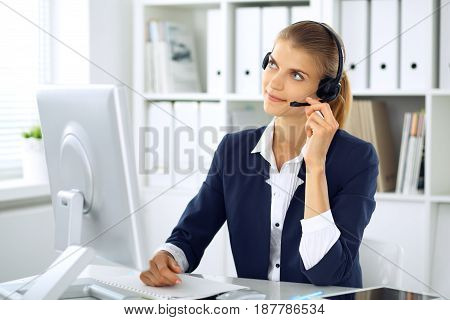 Modern business woman or student girl with headset in the office. Customer service operator at home work place. Success start up, education, call center concept