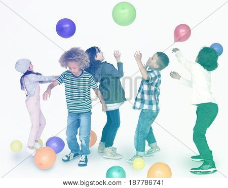 Group of young kids jumping and celebrating