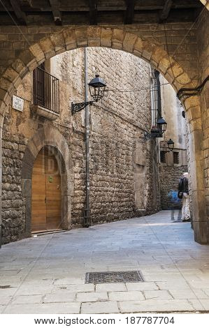 Narrow street in gothic quarter of Barcelona the capital city of the autonomous community of Catalonia in the Kingdom of Spain
